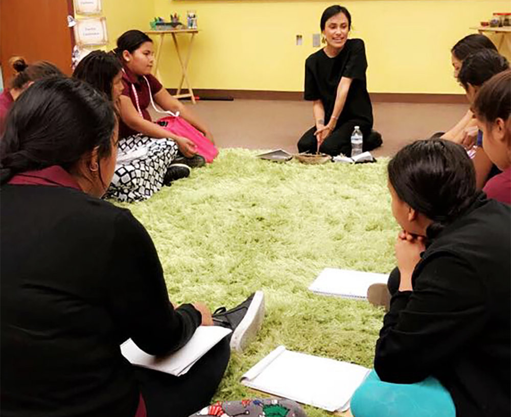 Laree Pourier (Oglala Lakota) leads a workshop with the girls at Anpo Wicahpi.