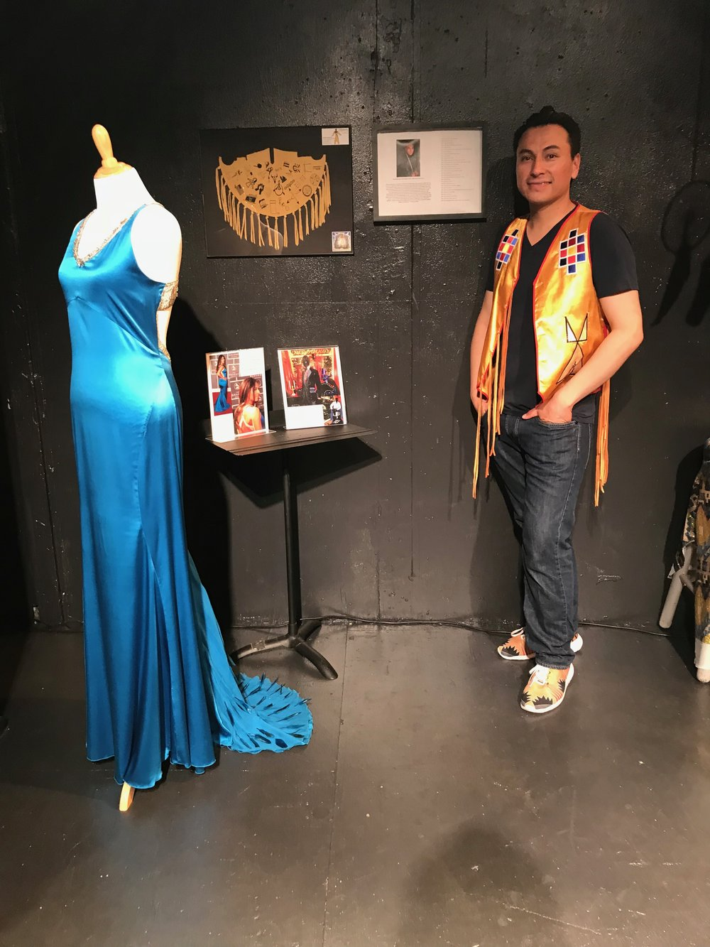 Sheldon with the dress he designed that was worn by Jana Mashonee at the 2007 GRAMMY Awards.