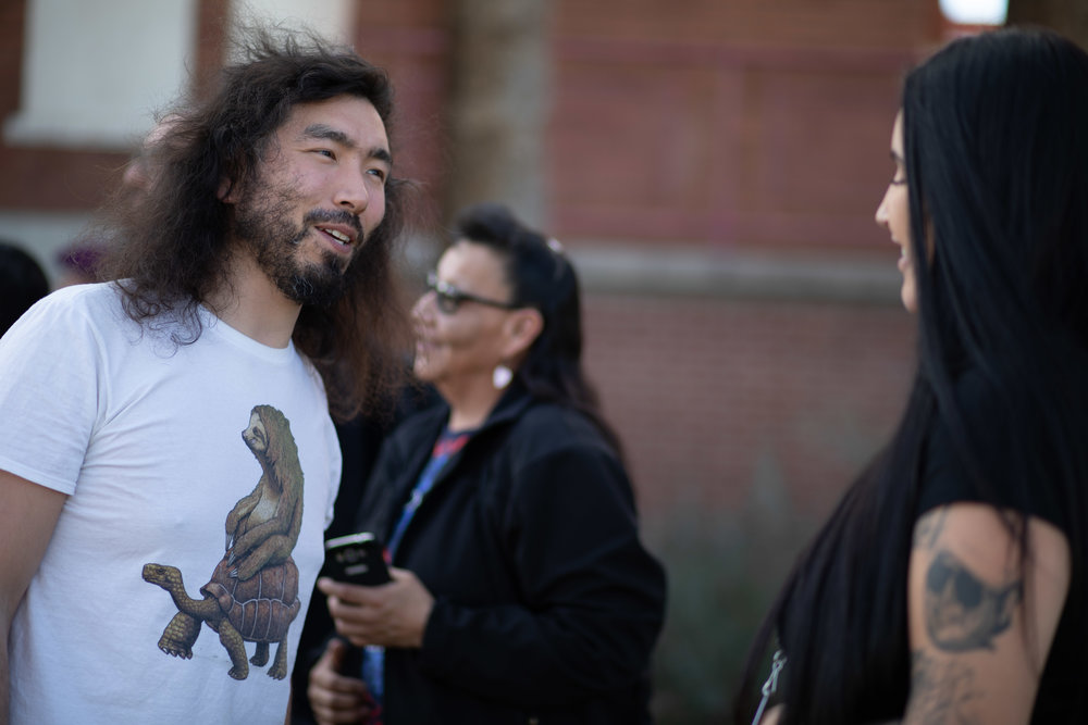 2019 Fellow, Peter Williams (Yup'ik) talks with Cassandra Waters (Colville), IAE Grantee site manager, Northwest Native Development Fund (NNDF).