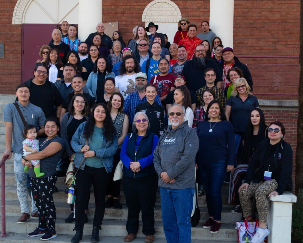 A group photo of the convening attendees on the front steps of the Phoenix Center for the Arts.