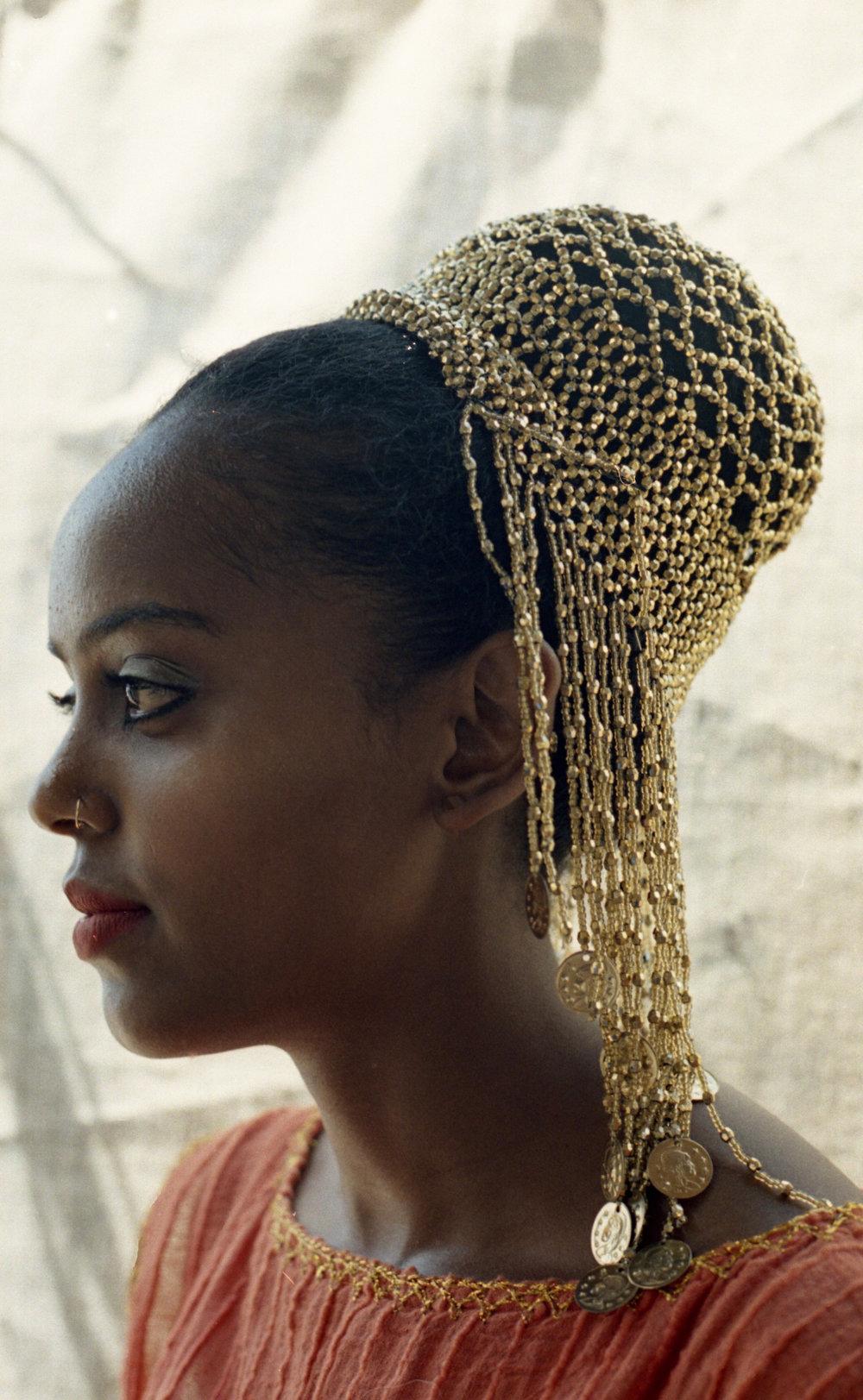 Feven, representing Ethiopia with a Dubai head piece