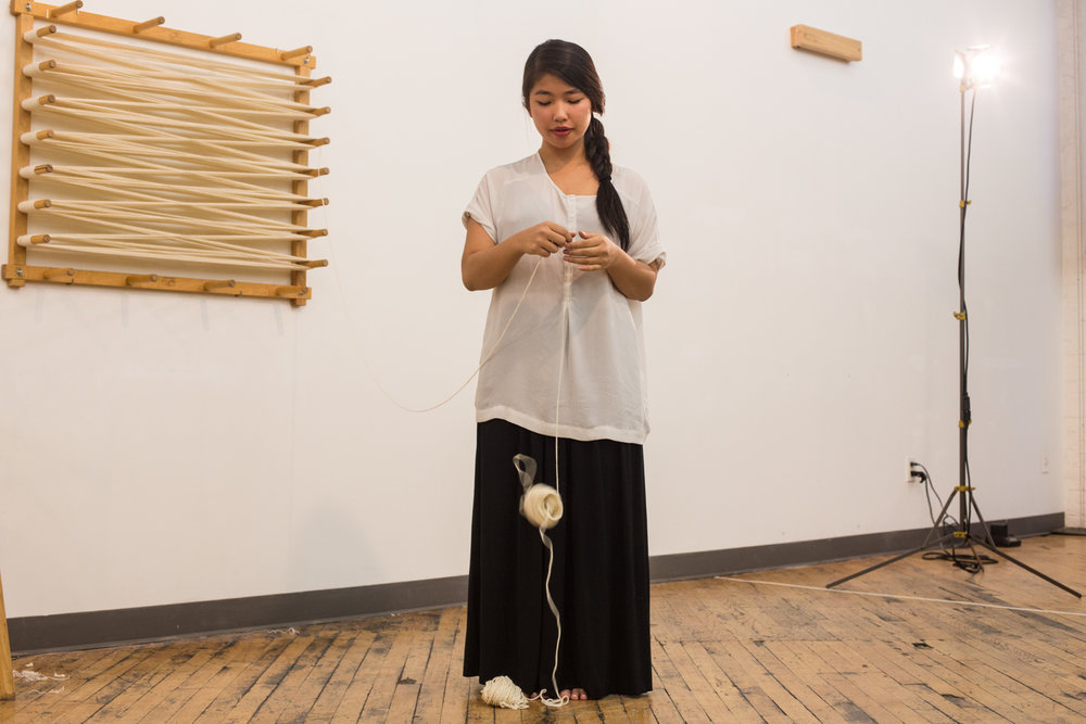 Artist drops the yarn from her hand when she counts to 60.