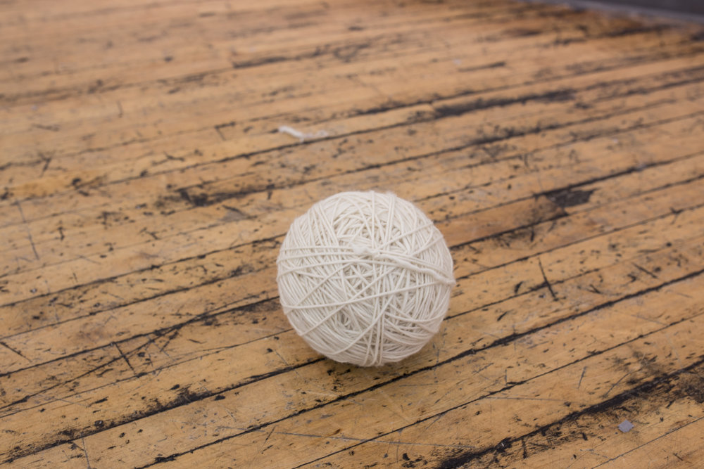 The ball of untangled yarn is on the floor to show that there's no knots.