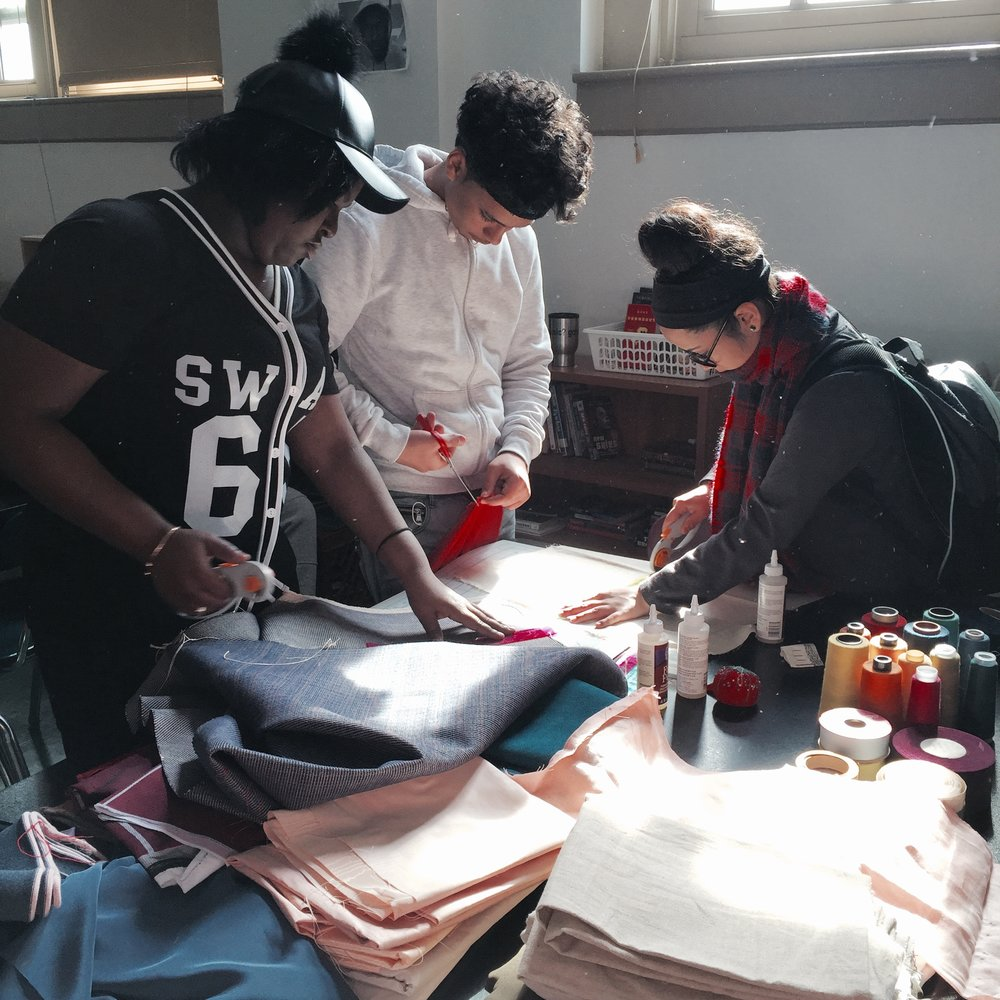 Students choose and cut fabric.