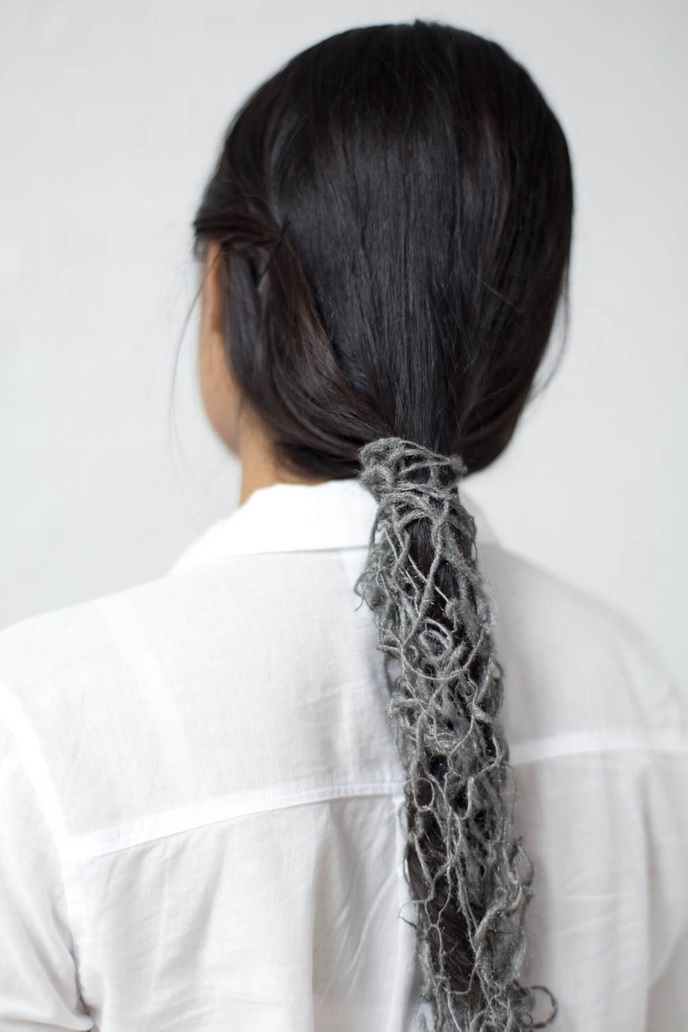 Hand-spun steel wool wrapped around Swati Kapur's hair