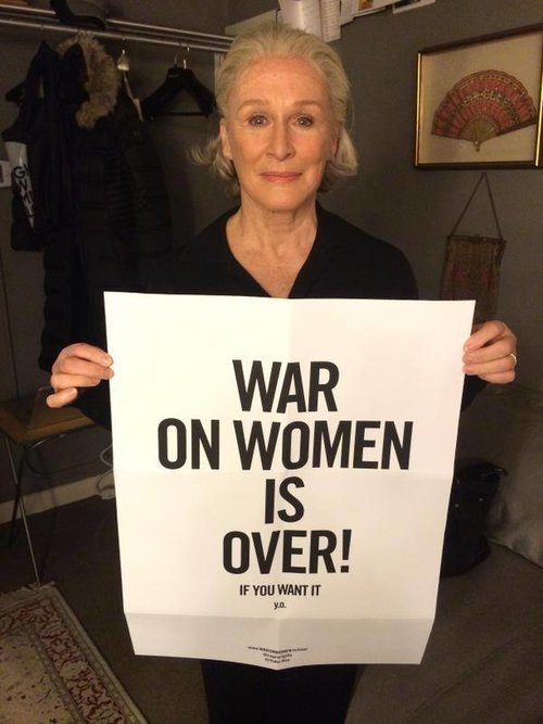 "Actress Glenn Close holding the ""War on Women is Over! If You Want It"" poster"