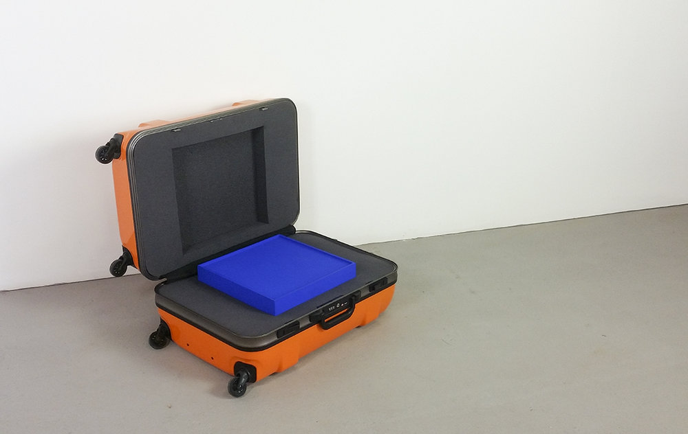Baggage, 2017. Suitcase, foam, timber canvas, choma key blue paint. 67 x 40 x 29cm. Studio installation view