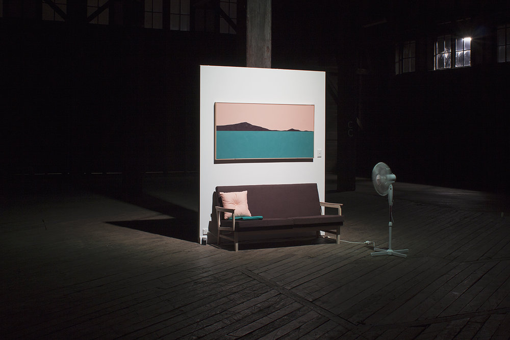 Landscape Imperative (Couch),  2015. With Chanelle Collier. Acrylic, canvas, timber, linen, gyprock, powerpoint, pedestal fan. 240 x 190 x 80cm. Installation View,  BANG,  Pier 2/3 Walsh Bay. Photo: Anna Cuthill