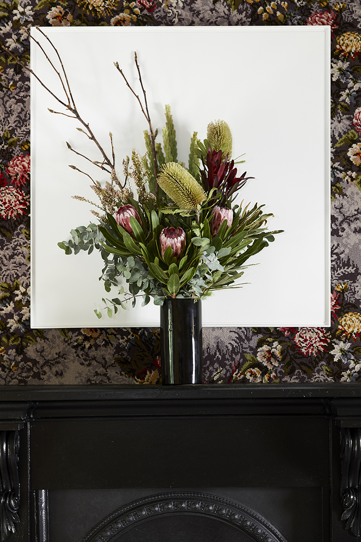 Detail: Joe Wilson and Chanelle Collier,  Still Life and Painting , 2018. Photo: Robin Hearfield   Still Life and Painting  reflects on historical traditions including still life and monochrome painting while also making use of a range of domestically orientated craftsmanship including floristry, carpet embroidery, metal pressing, and wood carving. This approach emphasizes that all objects are embedded with economic and historical meaning that require a perspicacious labour of viewing; that the insightful eye can glimpse humour from the mundane, hardship in beauty, and truths behind illusion.