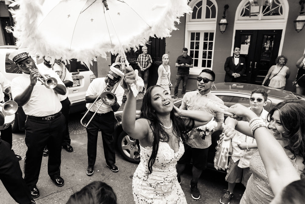 A bride getting down in a wedding second line with the Kinfolk brass band