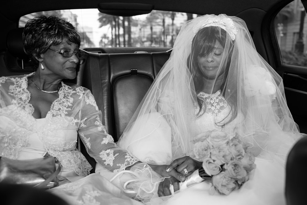 Mother and daughter share a moment before the wedding, New Orleans.