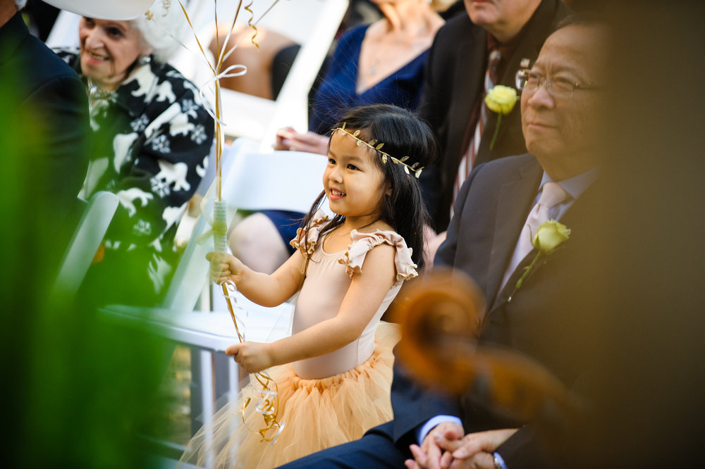 Flower girl in a New Orleans wedding at the Columns Hotel