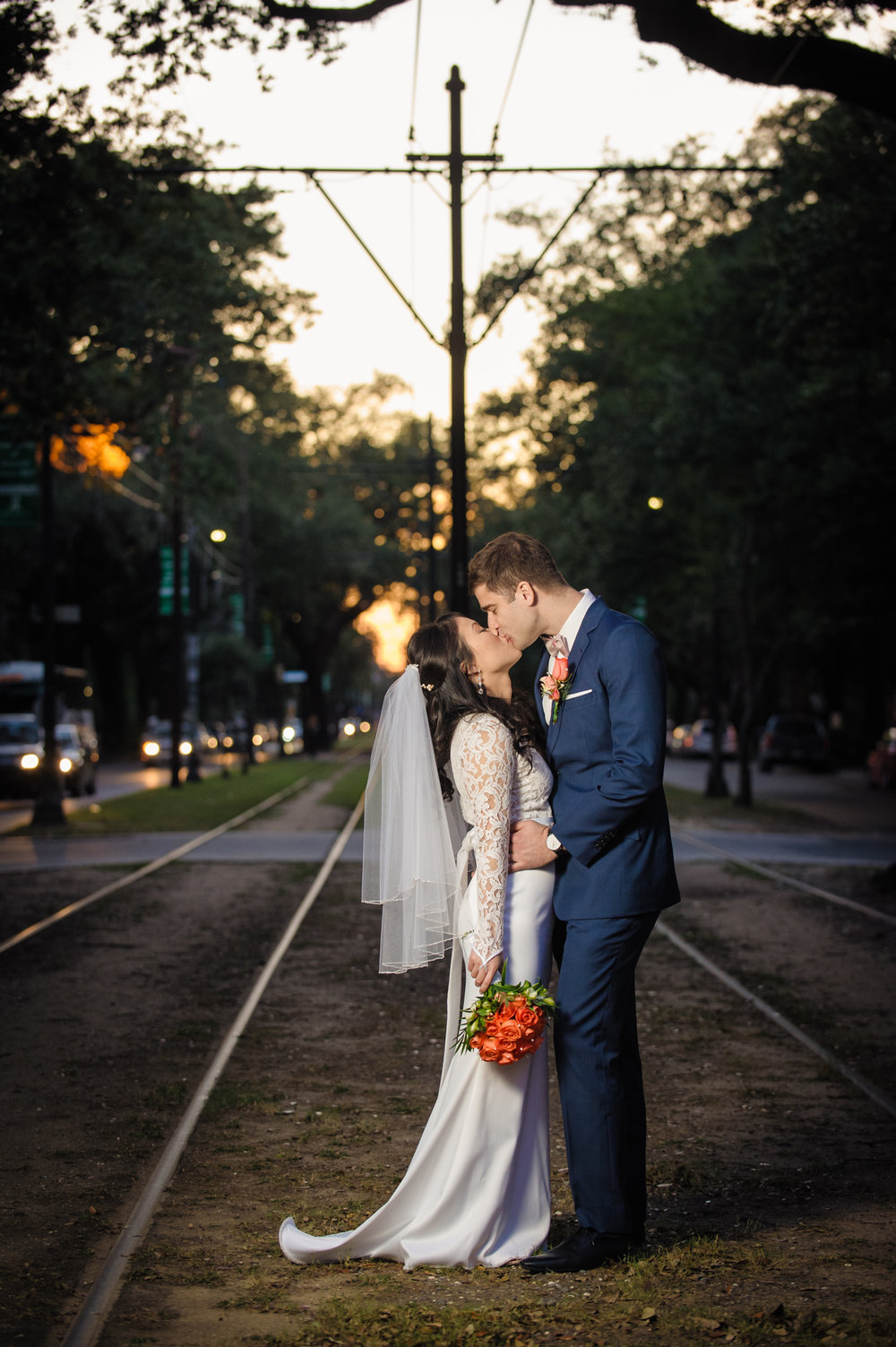 Post-wedding portraits on the St. Charles Avenue street car tracks in front of the Columns Hotel