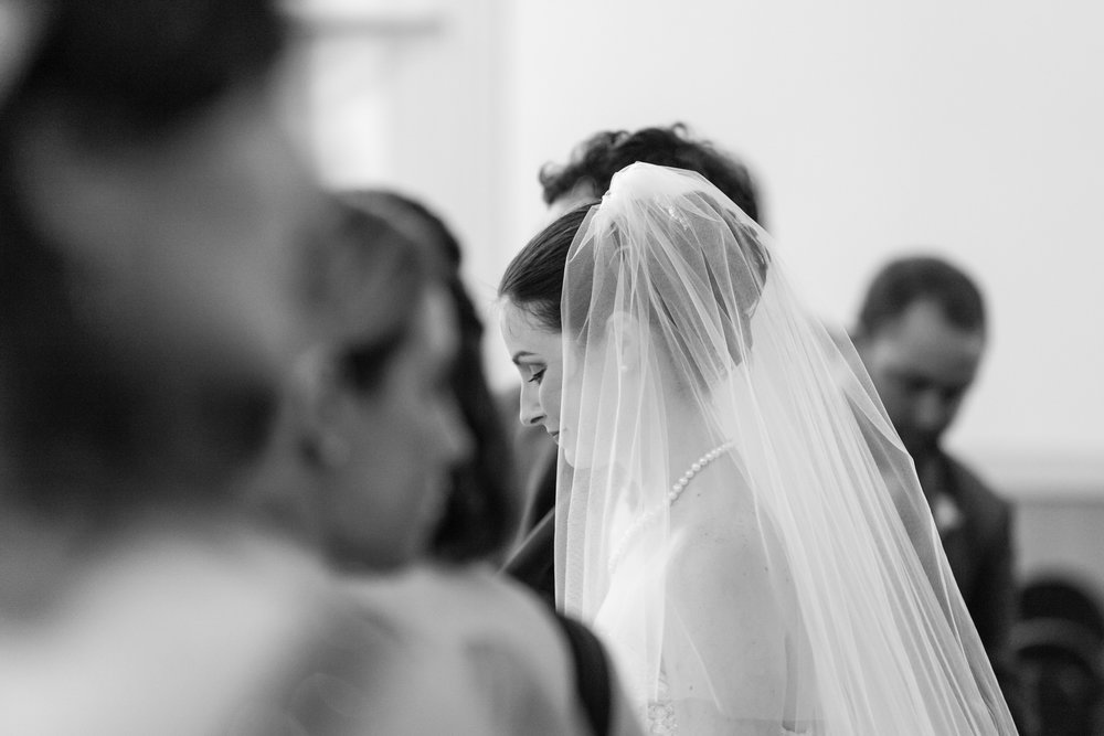 Solemn moment in a wedding ceremony at St. Louis Cathedral, New Orleans.
