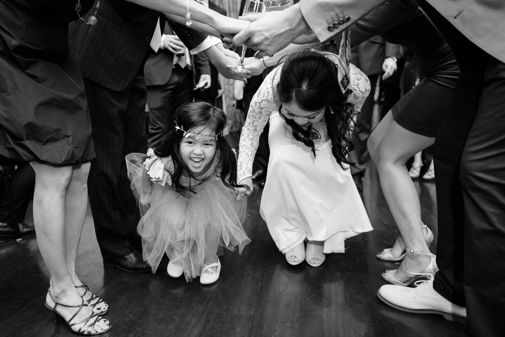 Bride and flower girl dancing at the reception, Columns Hotel, New Orleans