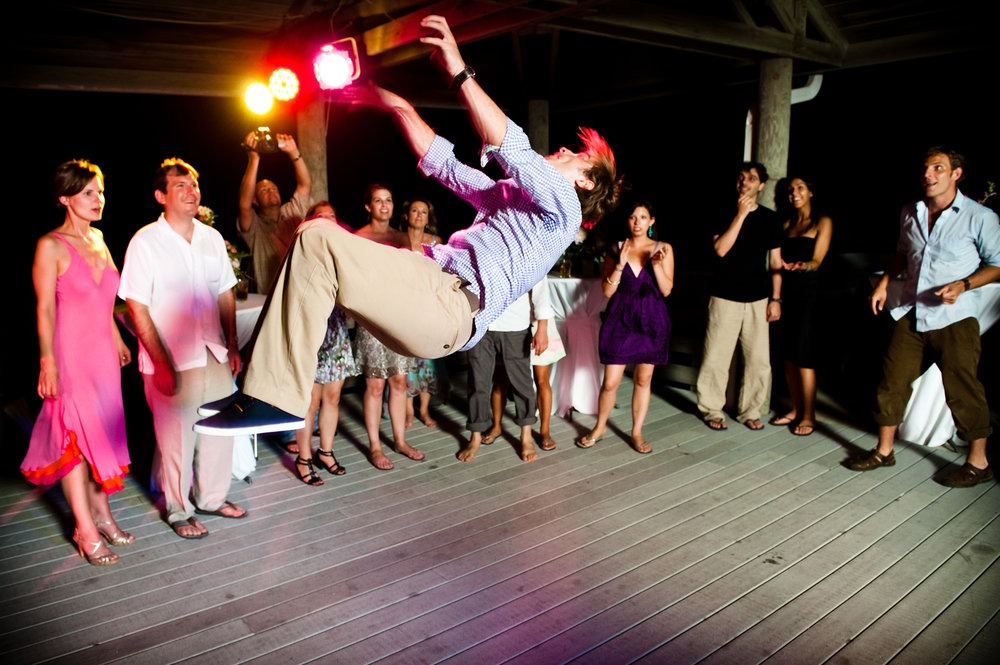 Guest doing a back flip at a wedding reception