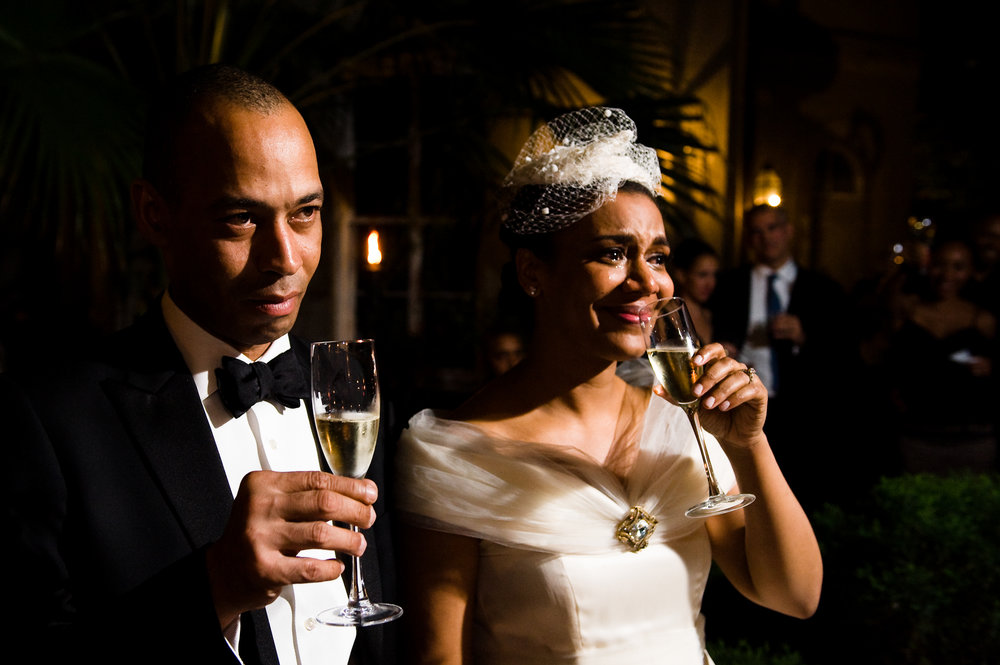 A bride and groom tear up during toasts at Cafe Amelie, New Orleans