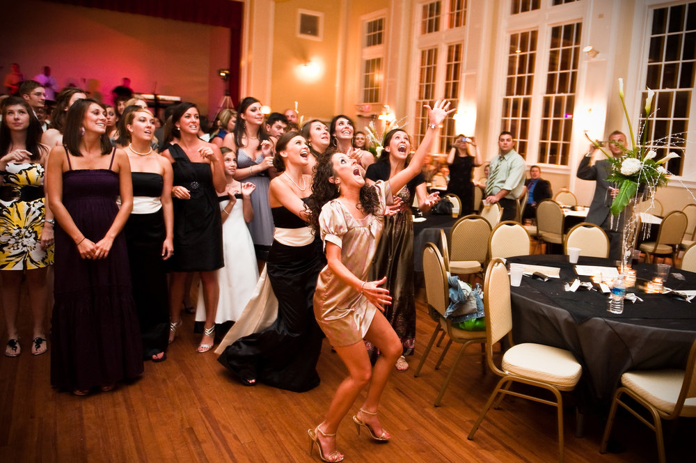 Bouquet toss in a New Orleans wedding, photographed by Scott Myers