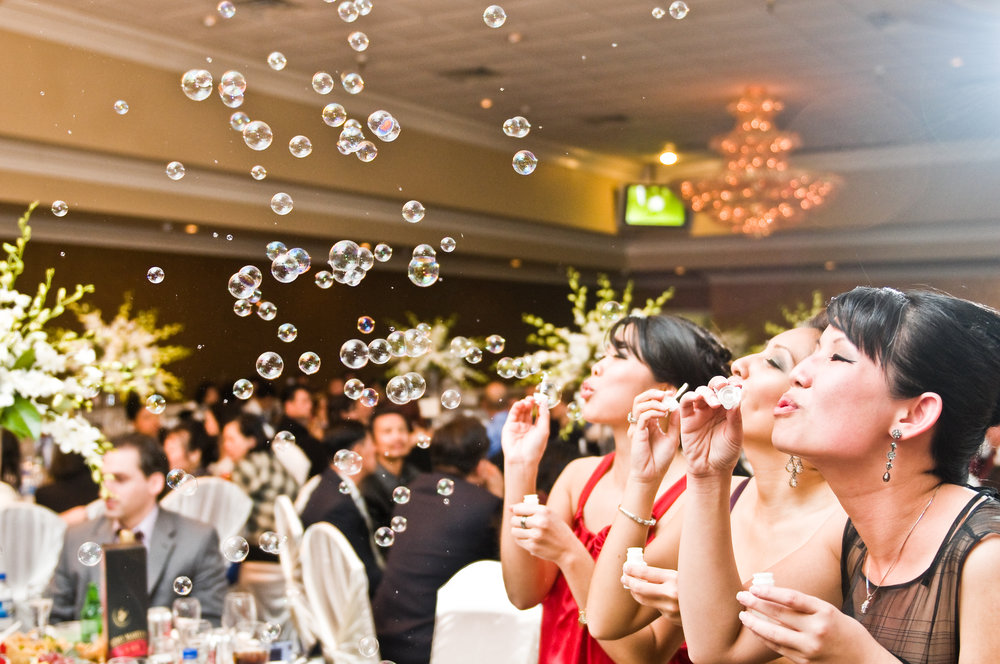 Bridesmaids blowing bubbles at a New Orleans wedding