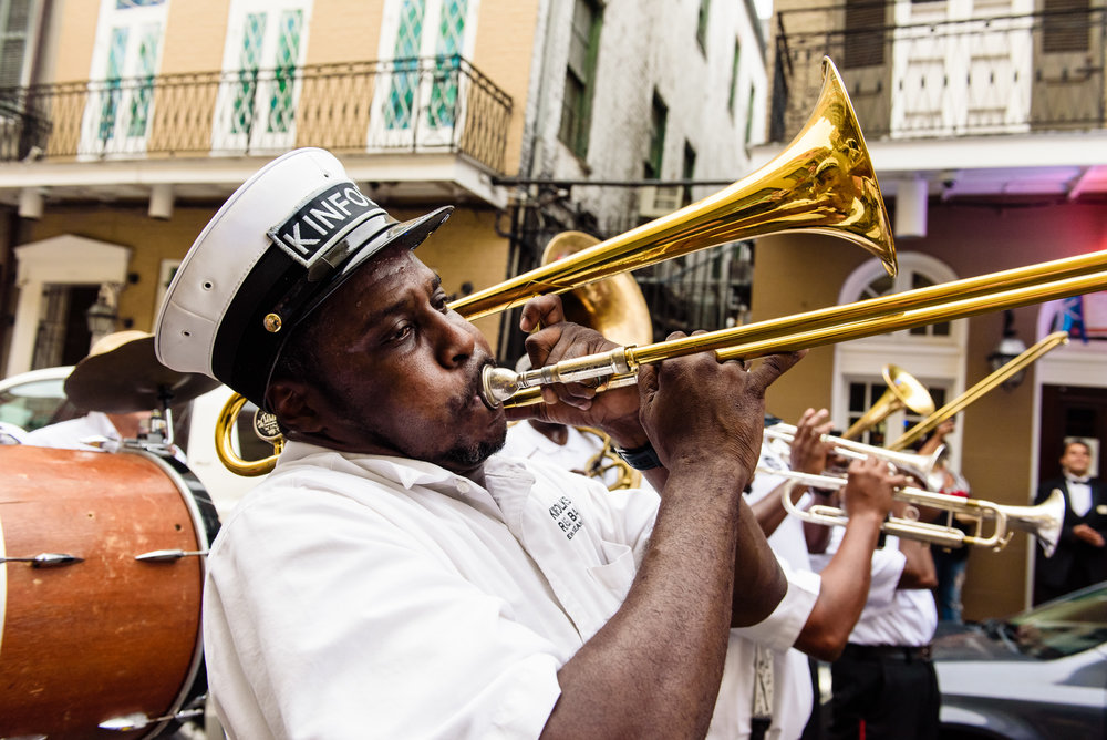 kinfolk brass band in a wedding second line parade