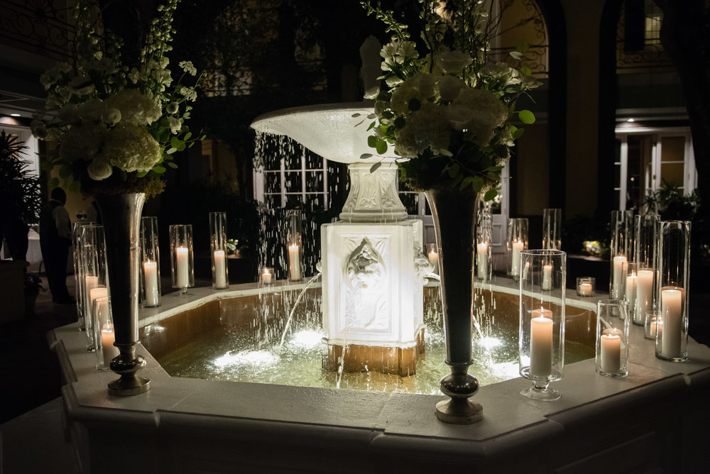 Candles and fountain at New Orleans' Hotel Mazarin