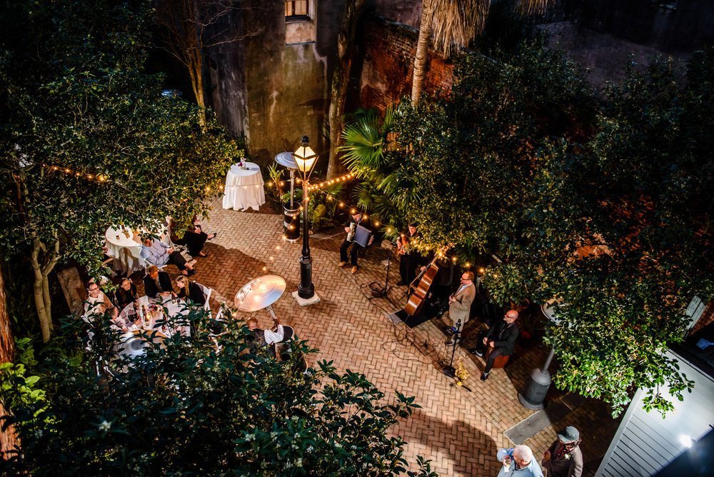Overhead shot of wedding reception at the New Orleans Pharmacy Museum, photographed by Scott Myers