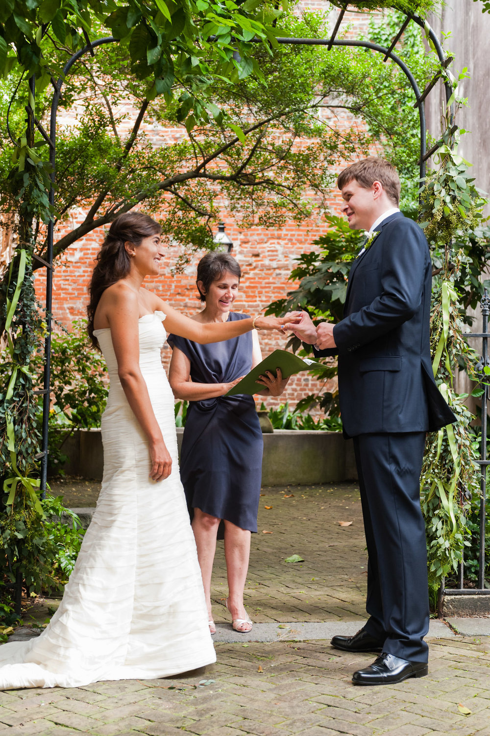 Exchanging rings at Wedding ceremony at the New Orleans Pharmacy Museum, photographed by Scott Myers