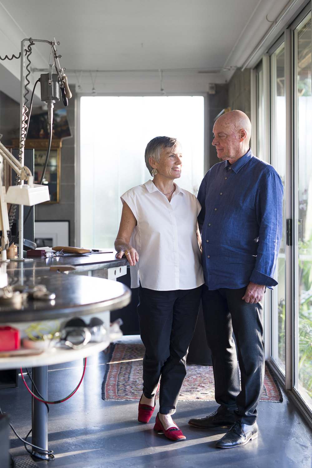 Barbara Heath (Barb) and Malcolm Enright (Mal) in their Jeweller to the Lost studio, the built-in lower level of their home, which houses a work desk, display area, workshop floor, and archive areas for Mal's ephemera and other collections.