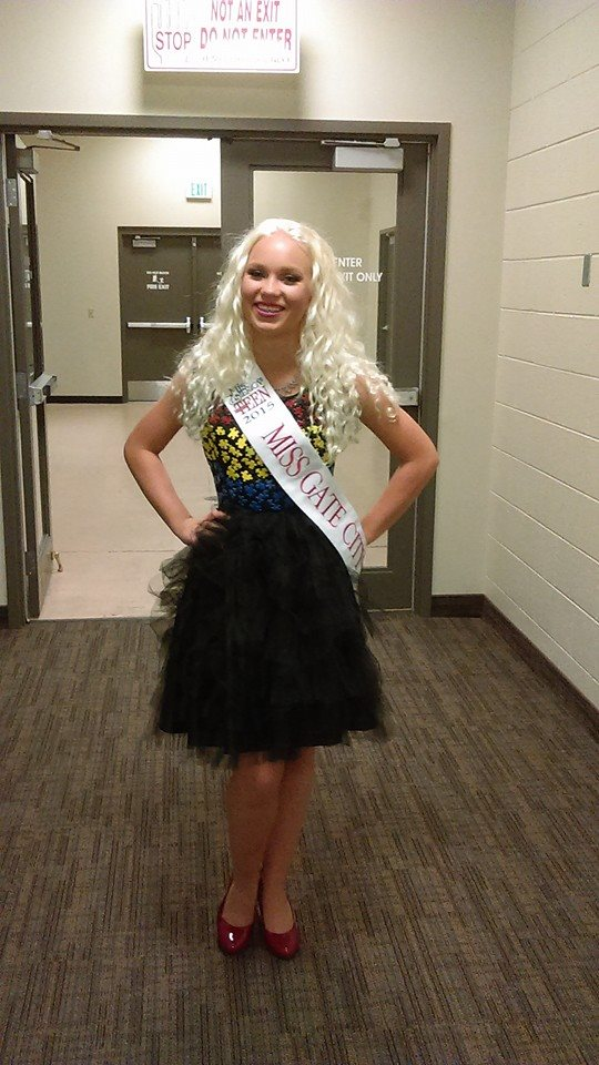 Miss Gate City Outstanding Teen 2015, Taesha Piersol, wearing Cartier Dior Designs at the Miss Teen Idaho Pageant. The dress is inspired by her platform of autism awareness. Materials: Satin, tulle, and puzzle pieces.