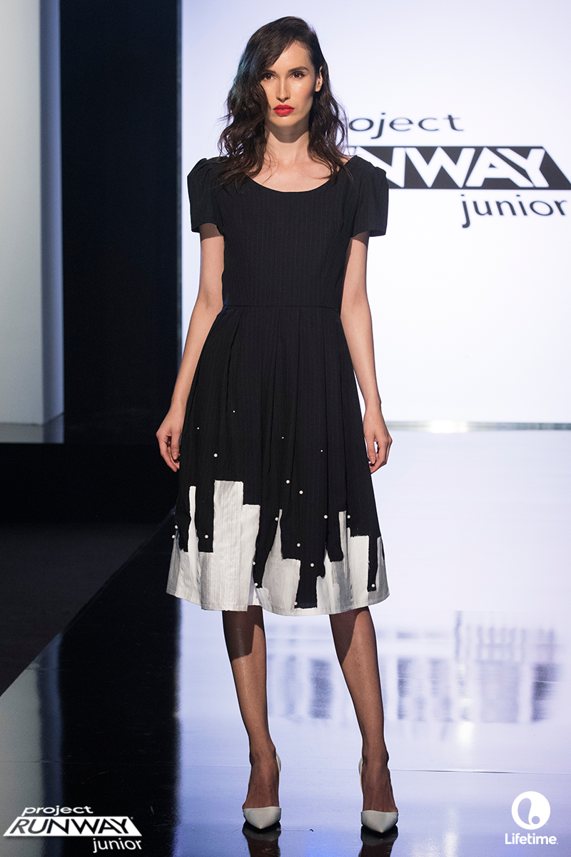 Project Runway: Junior S02E01. This dress is inspired by New York City at night and it is made from suiting with a hand painted city skyline.