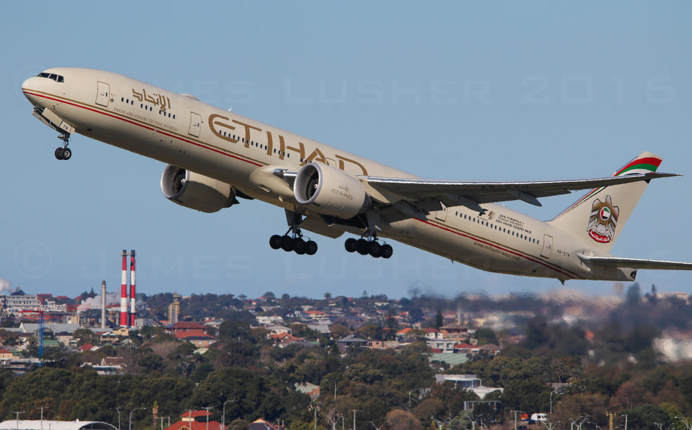Here's Etihad with a 34L Departure in the mid afternoon sun