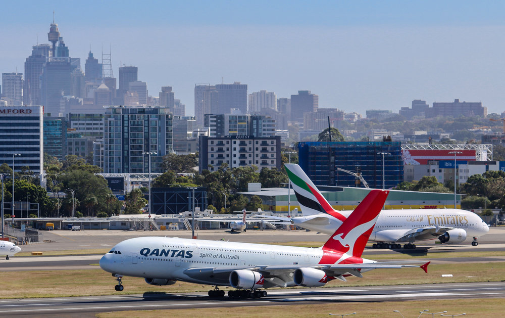 QF8 and EK412 with the Sydney CBD as a backdrop