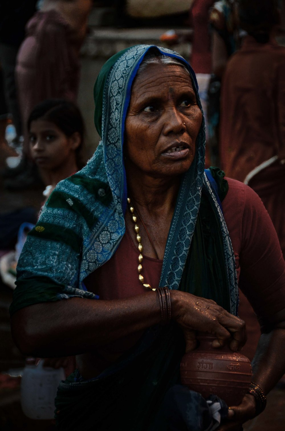 Woman with Urn (preparing to scatter ashes into the Ganges River), Varanasi, India 2012