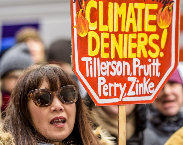 Typical climate change protestor.  We are unsure if the glasses are a required item.  This moronic protestor obviously forgot to do her homework and actually read Senate Confirmation Hearing transcripts.