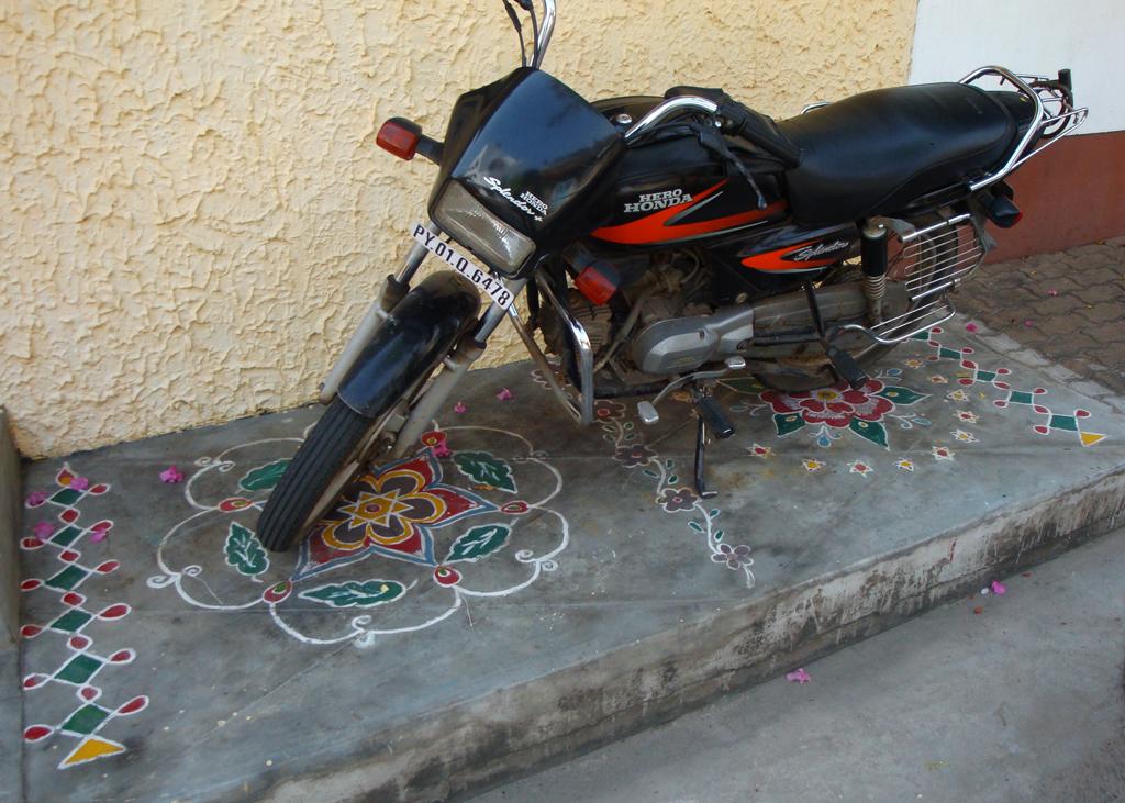 rangoli beneath bike