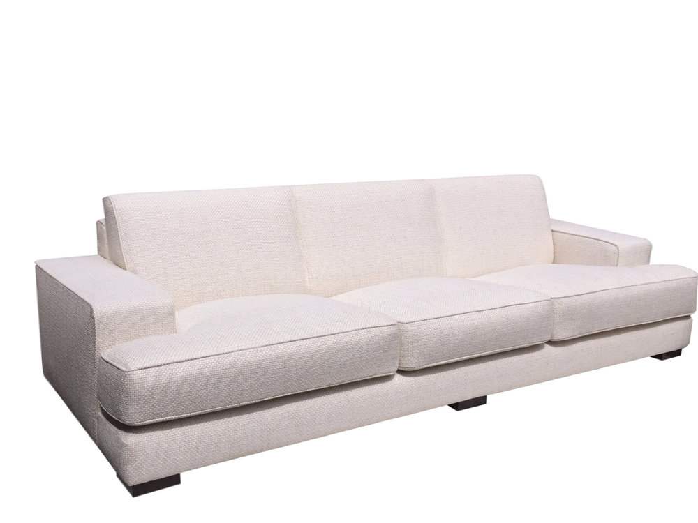 Sofa with sloped seat cushions and 20cm wide border