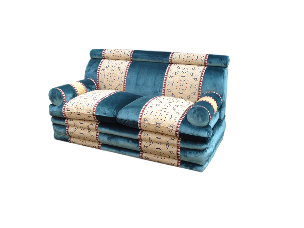Bolster arm sofa, with rolled base, headrest and lux cushions.