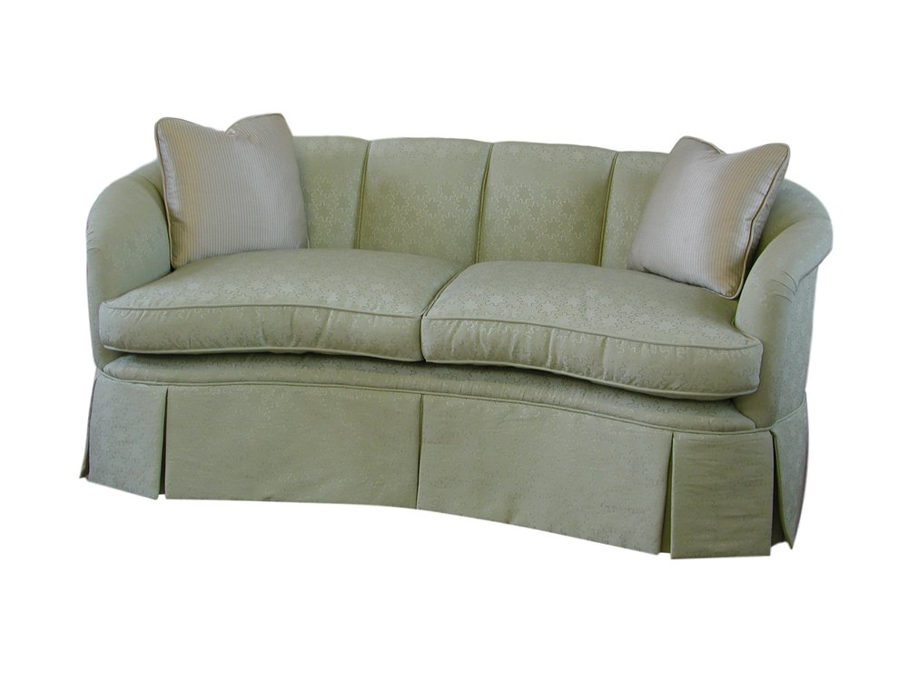 Manhattan style sofa, with fluted back and arms and high tailored skirt.