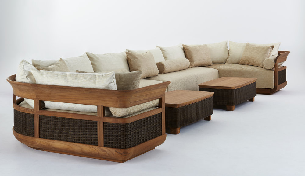 Burmese teak outdoor sofa and a pair of caned teak ottomans.