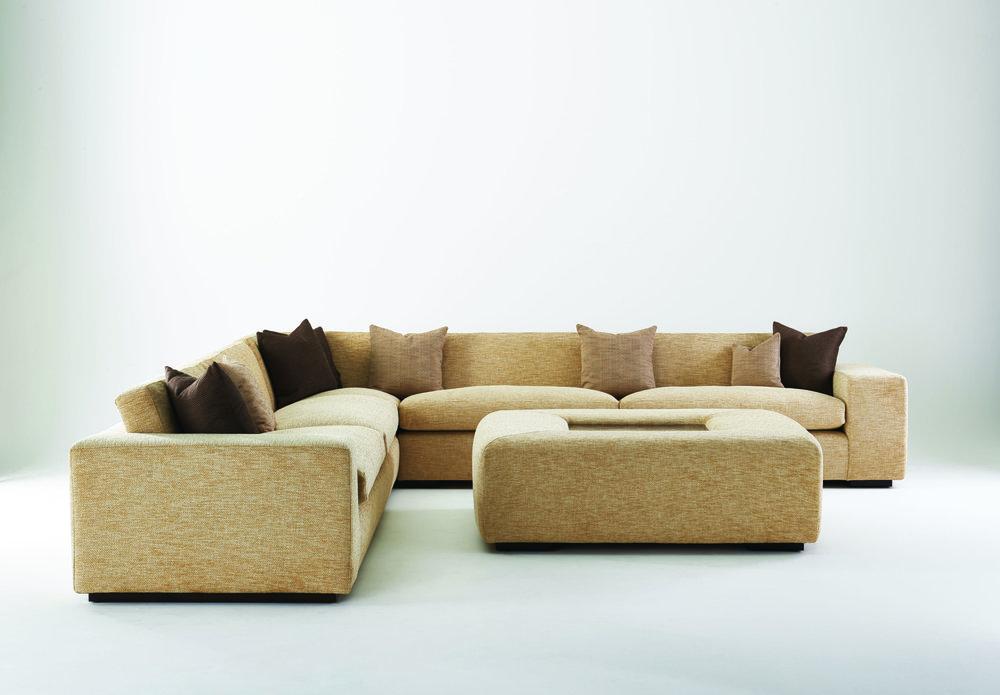 Sahara style sofa with Mahogany base and ottoman with showwood top.
