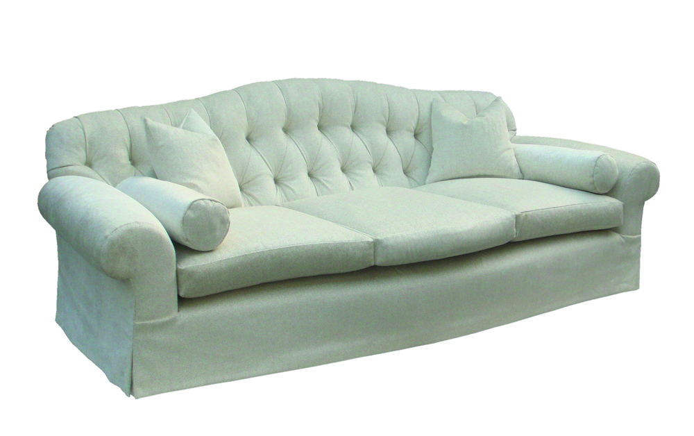 Buttoned back sofa with curved front