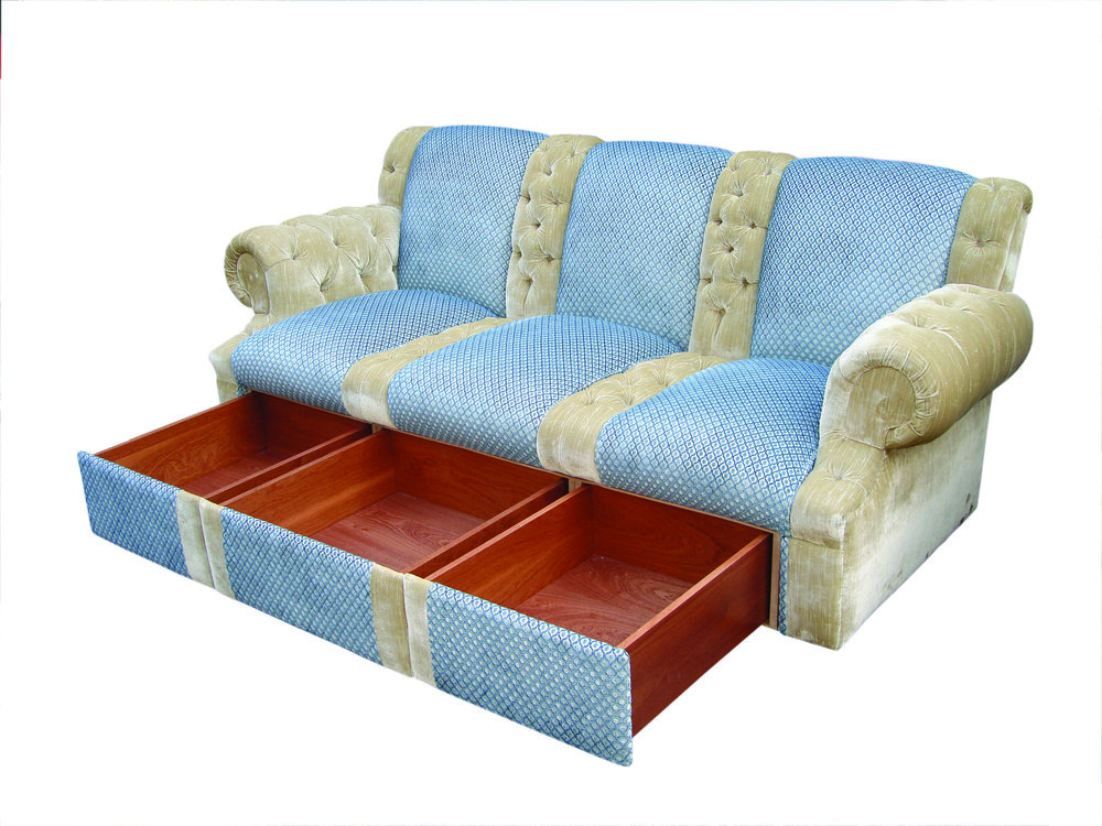 Panelled and deep buttoned sofa with drawers
