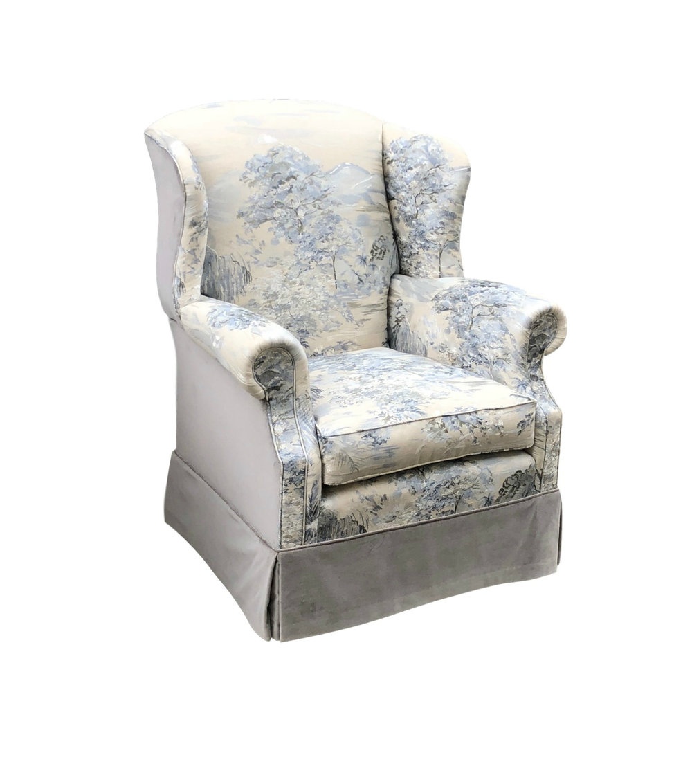Custom wing chair with swivel mechanism and kick pleat skirt