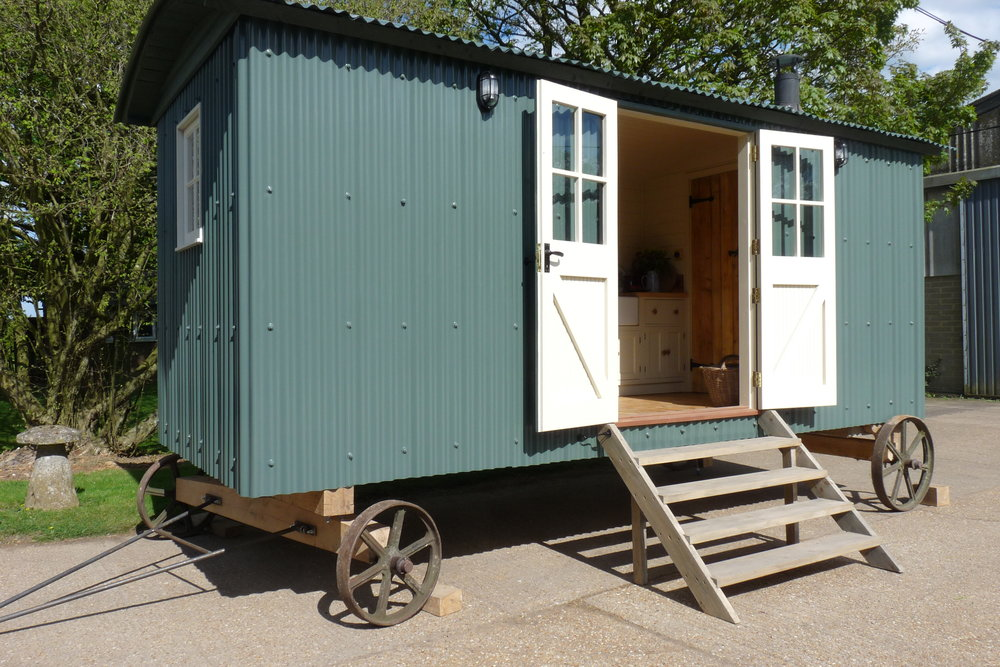 Our larger huts incorporate a shower room and kitchen. This one has a two burner ceramic hob , butler sink and mini fridge, perfect for guests or B&B or holiday letting. It has a full size shower with luxury shower fittings and toilet. There is comfortable seating and a table which convert to a full 5 feet bed.
