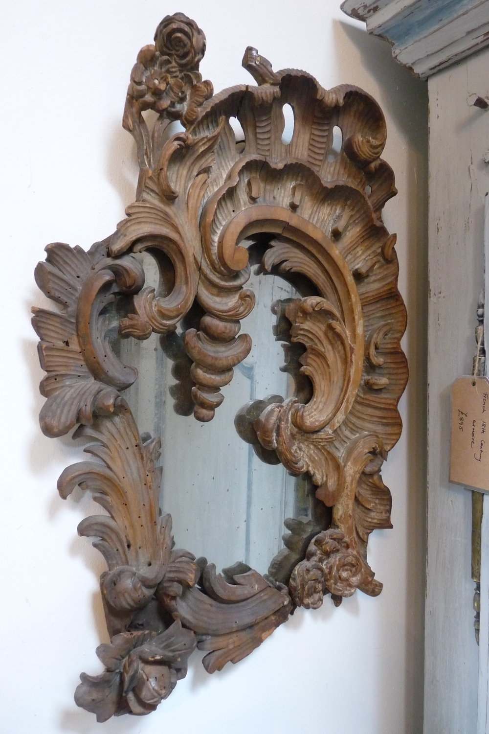 French 18th Century carved mirror. £295
