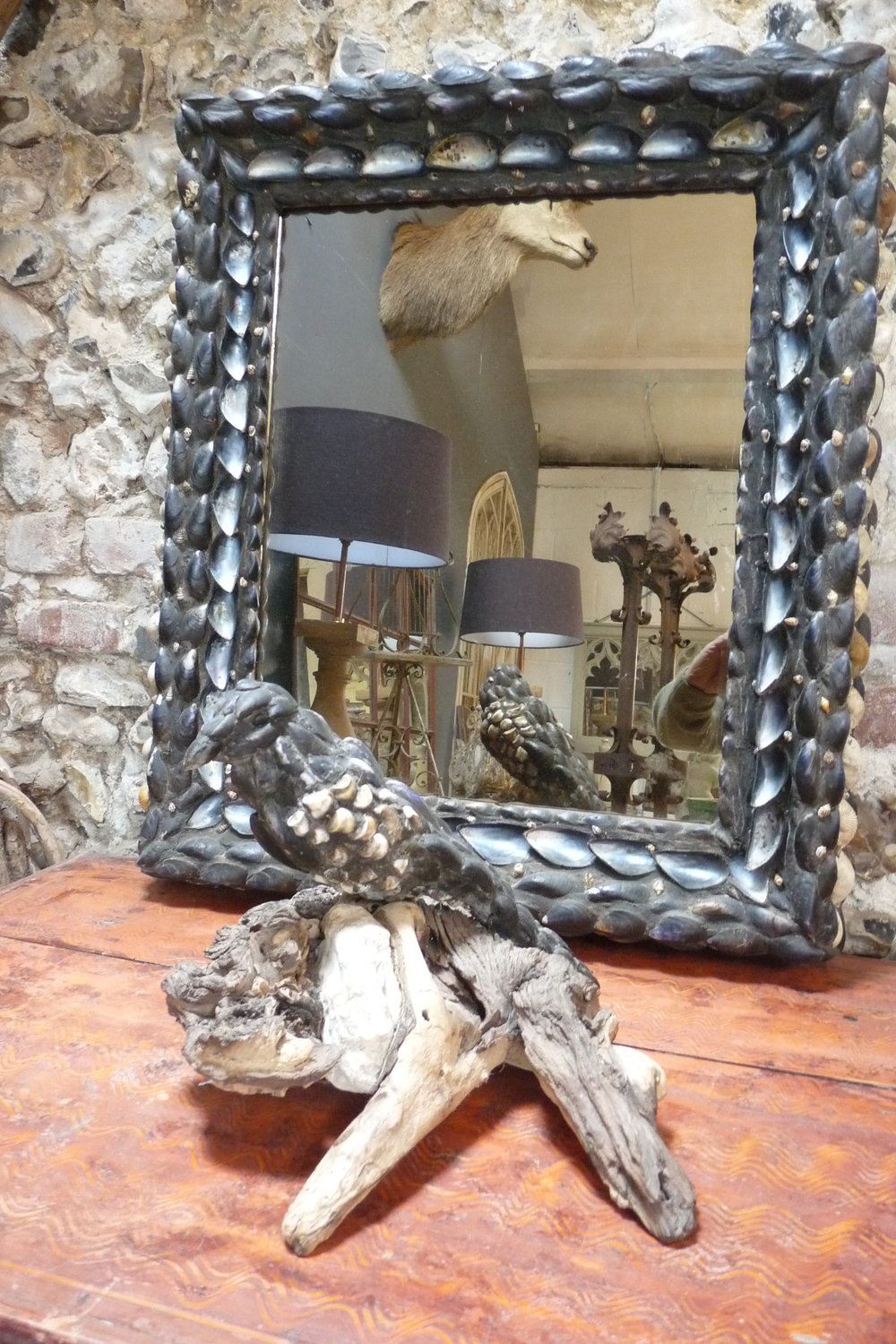 Antique mirror decorated with seashells. £375.  Driftwood and seashell magpie. £195.
