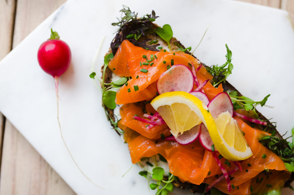 norwegian smoked salmon - sustainably sourced /  creme fraiche, microgreens, radish and chives