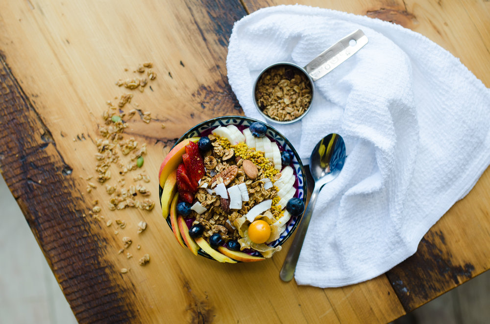 dragonfruit bowl - topped with house granola, banana, gooseberry, bee pollen, seasonal berries and fruit.