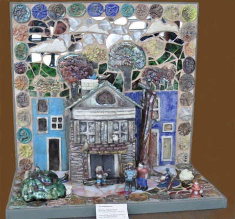 """Our Neighborhood II"" Another NCECA award winner! Shawn Terrel and Miles Guy worked on this piece for the 2012 exhibit. Hand made raku clay pieces with glass and mirrors. 28""H X 13"" D X 16"" W"