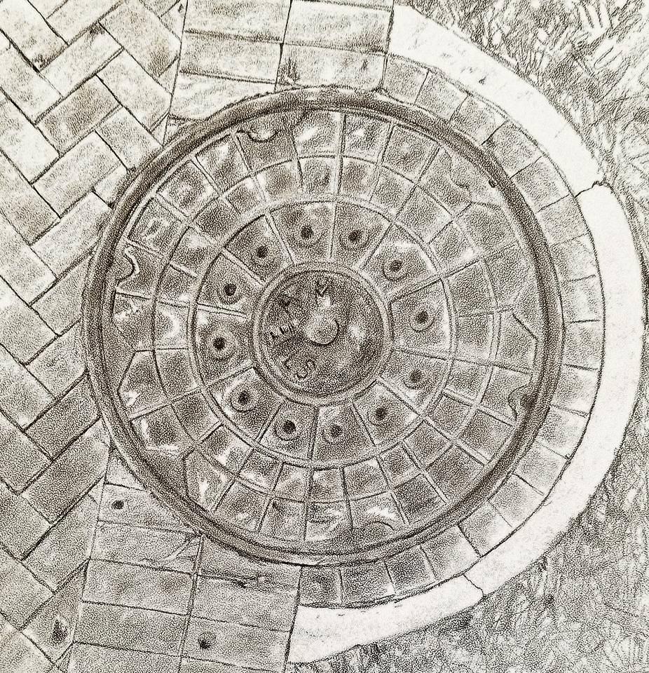 Manhole cover; graphite; 2017